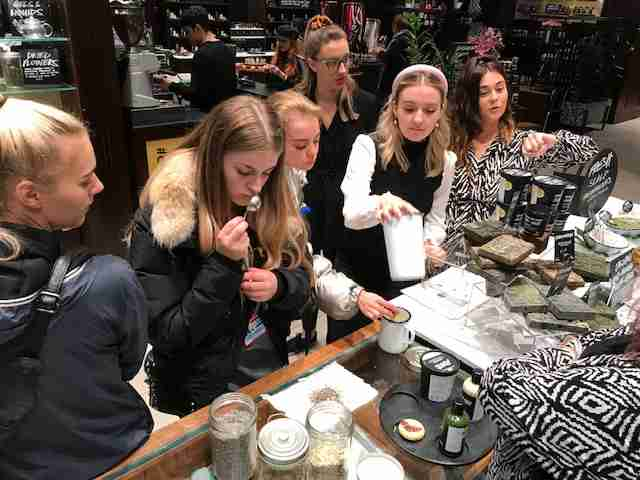 hairdressing apprentice smells hair product on shampoo workshop at lush liverpool